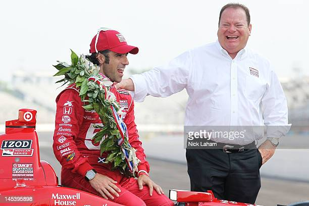 Three time winner, Dario Franchitti of Scotland, driver of the Target Chip Ganassi Racing Honda, poses with team owner Chip Ganassi, on the yard of...