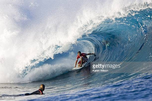 Three times ASP world surfing champion Hawaiian Andy Irons surges back into title contention at the Billabong Pro by beating Tahitian Kevin Johnson...