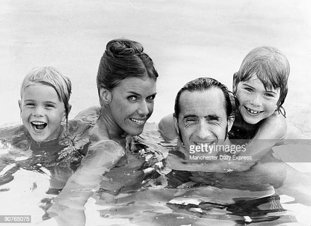 Three times formula one racing champion Jackie Stewart enjoys a swim with his wife Helen and sons Paul and Mark Stewart first became world champion...
