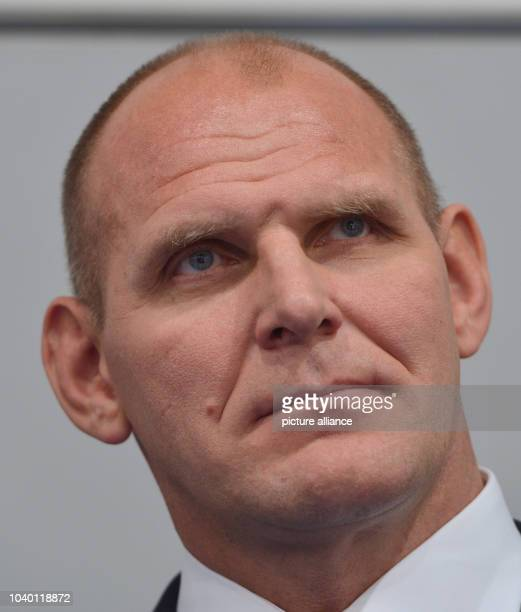 Three times Olympic gold medalist Alexander Karelin from Russia looks up during a press conference of the International Federation of Associated...