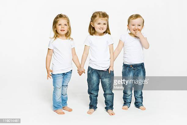 Three toddler girls holding hands
