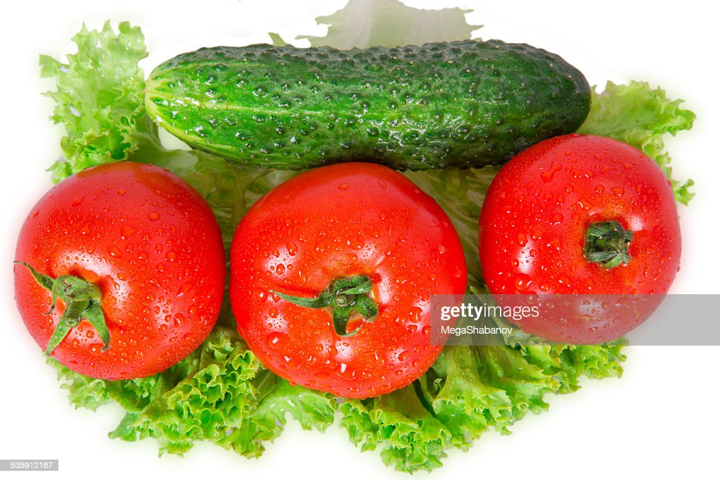 Three tomatoes and cucumber : Stock Photo