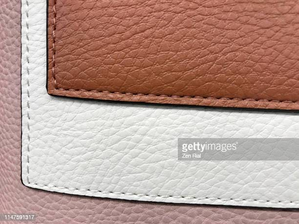 three tone colored handbag material with stitchings and layered effect - sac à main en cuir photos et images de collection