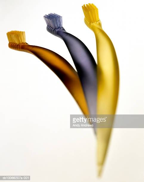 Three toothbrushes, close-up
