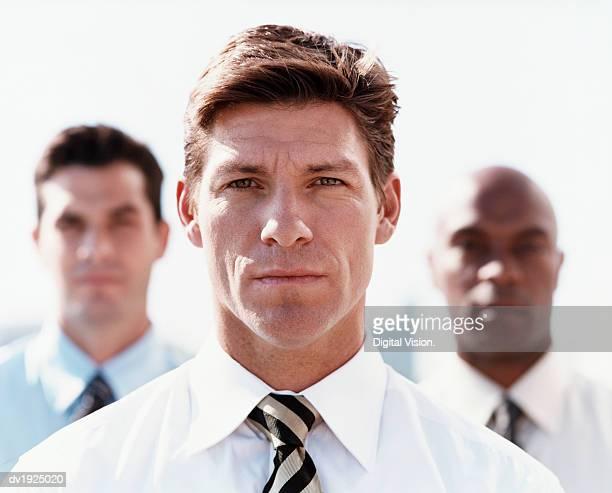 Three Tough Looking Businessmen
