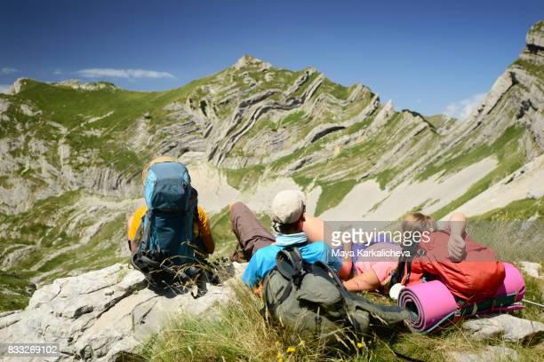 Three tourist in front of the amazing Sareni Pasovi in Durmitor mountain
