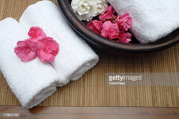 three towels on pamper mat