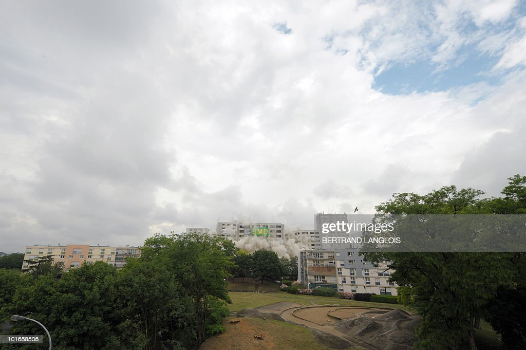 Three towers of 'La cite des Indes' are being demolished by controlled explosions, on June 6, 2010 in Satrouville, near Paris. The tree towers, of 251 apartments and dating back to the 1970's, will be destroy as part of the urban renovation program.
