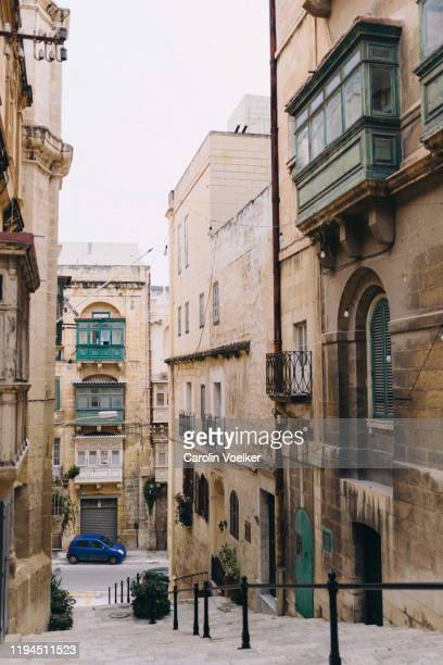 three traditional maltese balconies in shades of green on a building in the center of valletta, malta - ワイドショット ストックフォトと画像