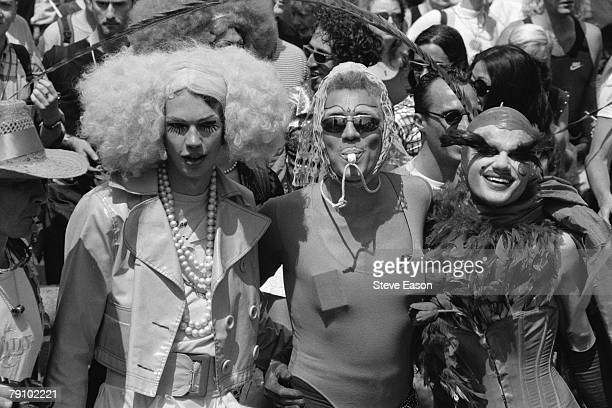 Three transvestite men at a Gay Pride Parade London 6th July 1996