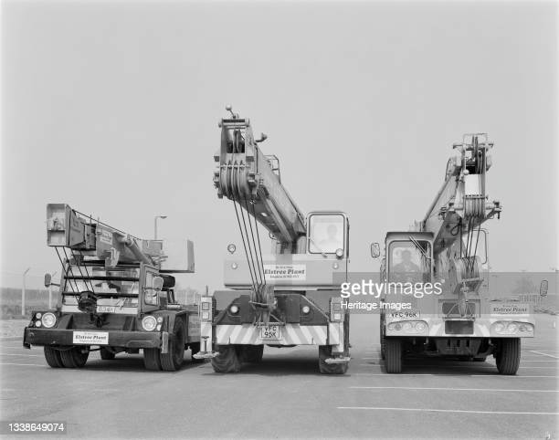 Three truck-mounted cranes hired from Elstree Plant lined up on the site of the Isle of Grain Power Station. The Isle of Grain Power Station was an...