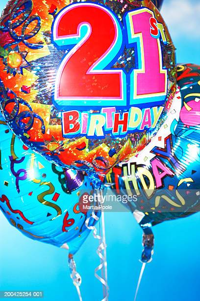 Three twenty first birthday balloons, close-up