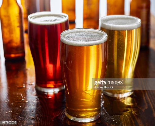 three types of beer, red ale, ipa, and stout - help:ipa stock pictures, royalty-free photos & images
