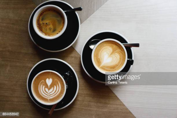 Three types of specialty coffees with coffee art