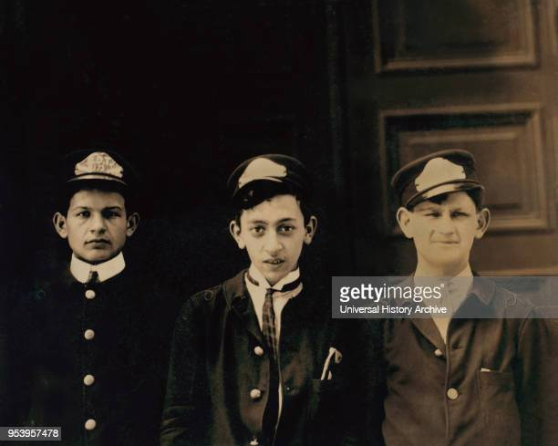 Three Typical ADT Boys HalfLength Portrait Broadway near 40th Street New York City New York USA Lewis Hine for National Child Labor Committee July...