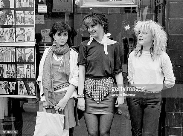 Three unidentified fashionconscious young women pose outside the window of the 'BOY' clothing boutique Kings Road Chelsea London England 1981