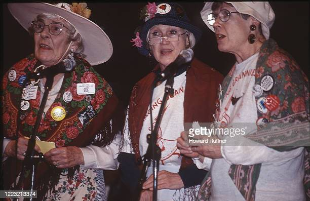 Three unidentified members of the Raging Grannies activist organization sing during the Hague Appeal for Peace conference, the Hague, Netherlands,...