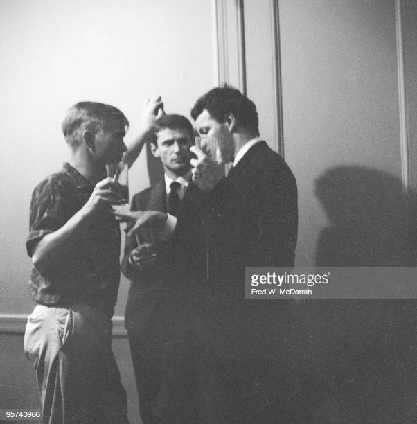 Three unidentified men speak at the opening night party for the Living Theatre's production of Jack Gelber's play 'The Connection' New York New York...