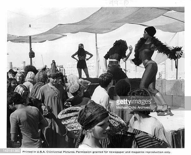 Three unknown actresses on stage dancing for a crowd in a scene from the film 'Jesus Christ Superstar', 1973.