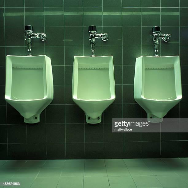 Three Urinals in public restroom
