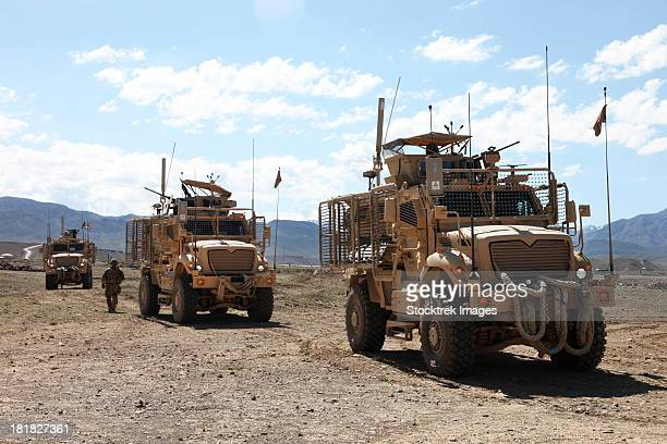 three u.s. army mine resistant ambush protected vehicles. - us military stock pictures, royalty-free photos & images