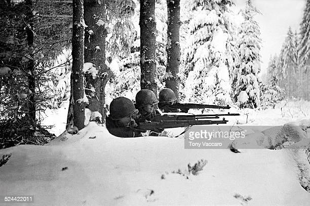 Three US infantrymen in the snow during the Battle of the Bulge Ardennes Belgium World War II January 1945