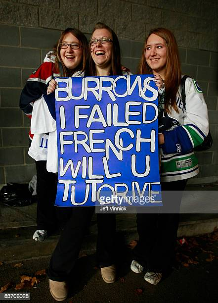Three Vancouver Canucks fans wait for the arrival of Vancouver Canuck player Alex Burrows before the game against the Toronto Maple leafs at General...