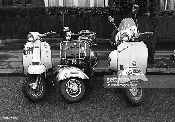 Three Vespa scooters lined up together mods London 1964
