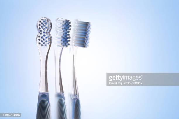 Three Views Of Transparent Blue Toothbrush Isolated Blue