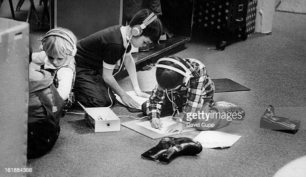 NOV 12 1975 NOV 15 1975 NOV 16 1975 Three Vista Grande School Pupils Receive Instructions for Rhyming Task Through Their Headsets They are part of a...