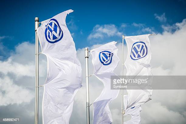 three volkswagen flags in the wind - volkswagen stock pictures, royalty-free photos & images
