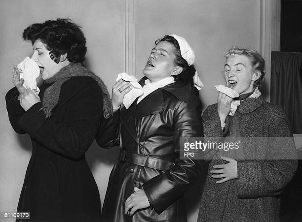 Three volunteers are infected with the common cold virus for research purposes at the Harvard Hospital in Wiltshire 28th December 1955 From left to...