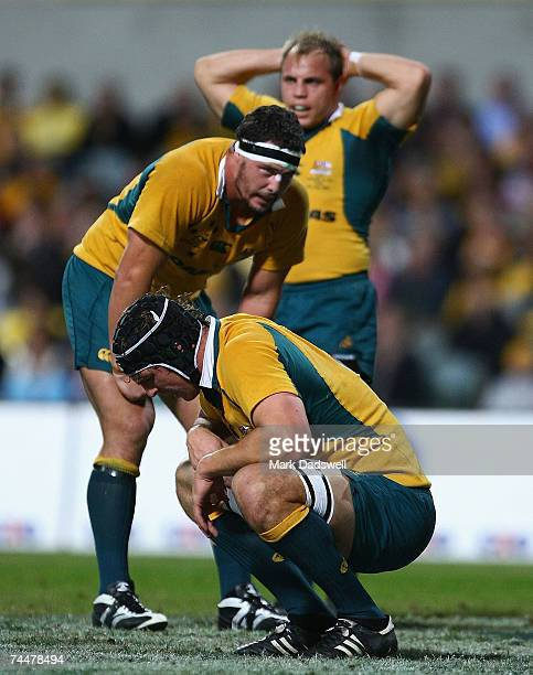 Three Wallabies show their exhaustion during the Test match between the Australian Wallabies and Fiji at Subiaco Oval June 9 2007 in Perth Australia