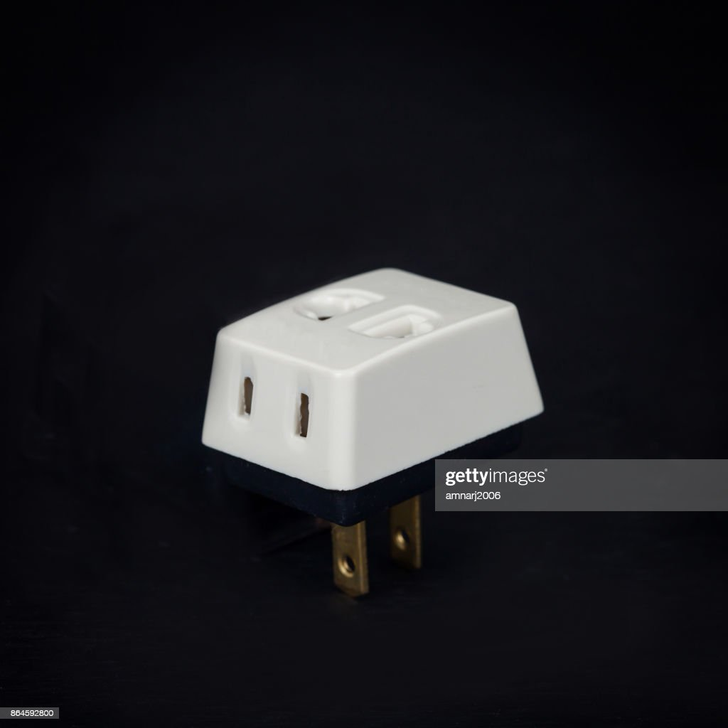 Three Way Plug For Home Electric On Background Stock Photo | Getty ...