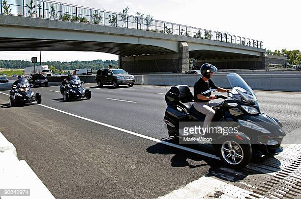 Three wheeled motorcycles travel over the Woodrow Wilson Bridge on September 4, 2009 in National Harbor, Maryland. The American Automobile...