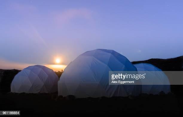 Three white dome tents at sunset, Narsaq, Vestgronland, South Greenland