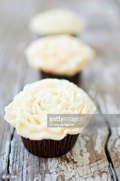 Three White Flower Buttercream Cupcakes