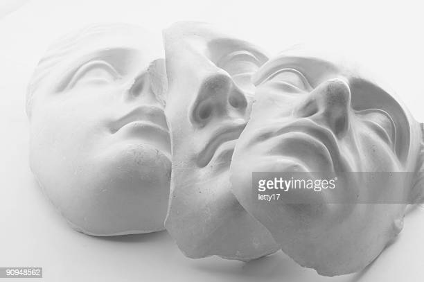 three white gypsum faces - sculptuur stockfoto's en -beelden