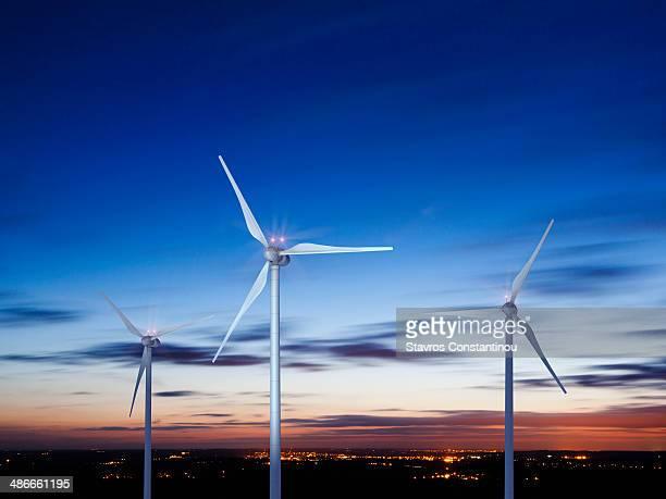 Three wind turbines against night sky