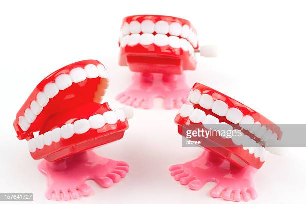 Three wind up chattering teeth toys on white