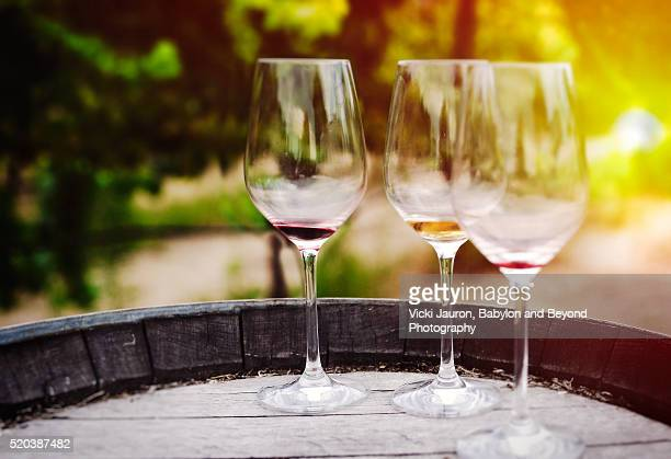 Three Wine Glasses on Barrell at Vineyard in Sonoma, California