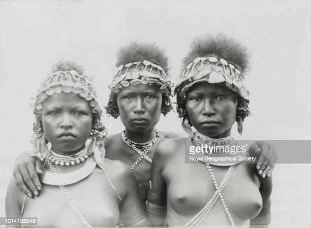 Three wise women Balaa girls wearing ornaments worn at dances Papua New Guinea 1898