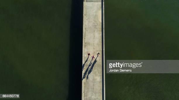 three woman jogging - 中距離 ストックフォトと画像