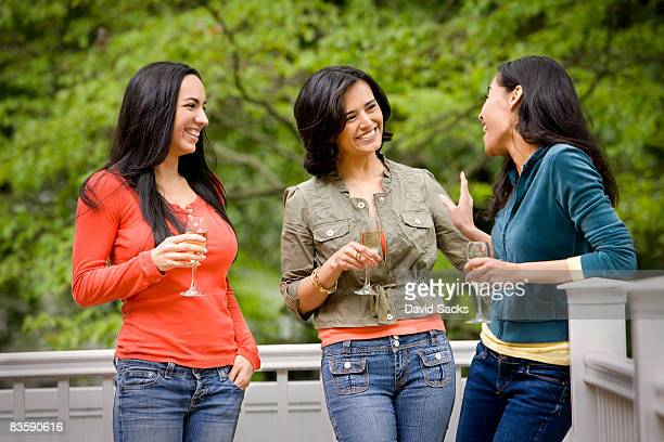 Three woman talking on back porch