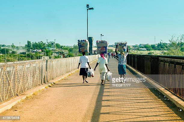 three woman with groceries accross beit bridge - limpopo province stock pictures, royalty-free photos & images