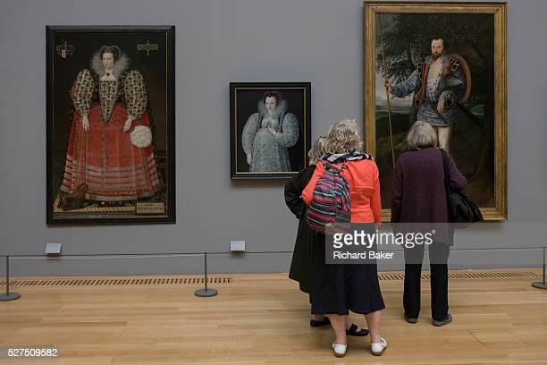 Three women admire Tudor portraits of Elizabethan nobility in Tate Britain London On the left is a portrait of Mary Kytson of Lady Darcy of Chiche...