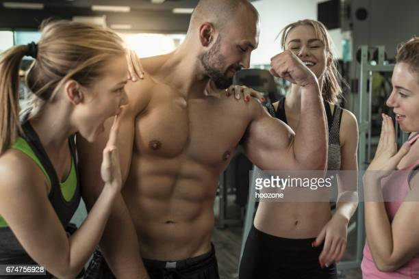 three women admiring mens big muscles at gym - vanity stock pictures, royalty-free photos & images