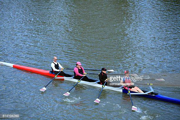 Three Women And One Male Rowing In The Local Regatta