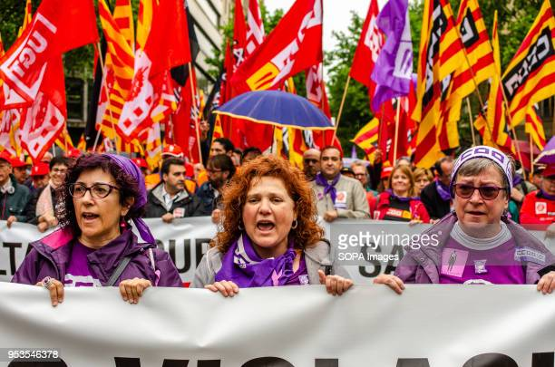 Three women are seen behind a banner during the demonstration 50000 people have demonstrated in the streets of Barcelona convened by the majority...