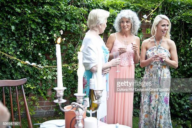 Three women chatting at garden party